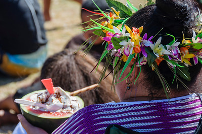 Pacific woman wearing a garland of flowers eating ice cream in a water melon container Pasifika Western Springs