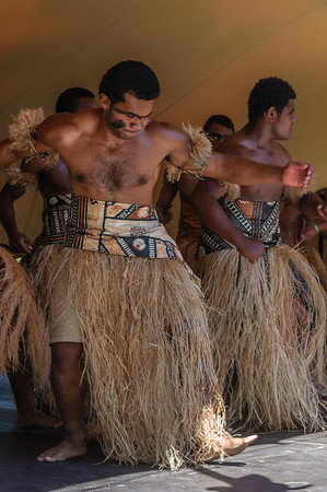 Fijian men dancers on stage Pasifika Western Springs