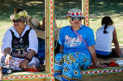Three women sitting in the shade of the Tokelau pavilion Pasifika Western Springs