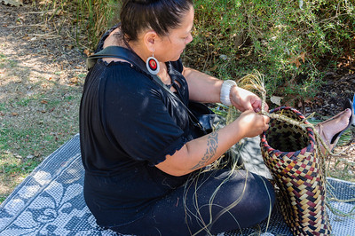 Pacific woman weaving a basket Pasifika Western Springs