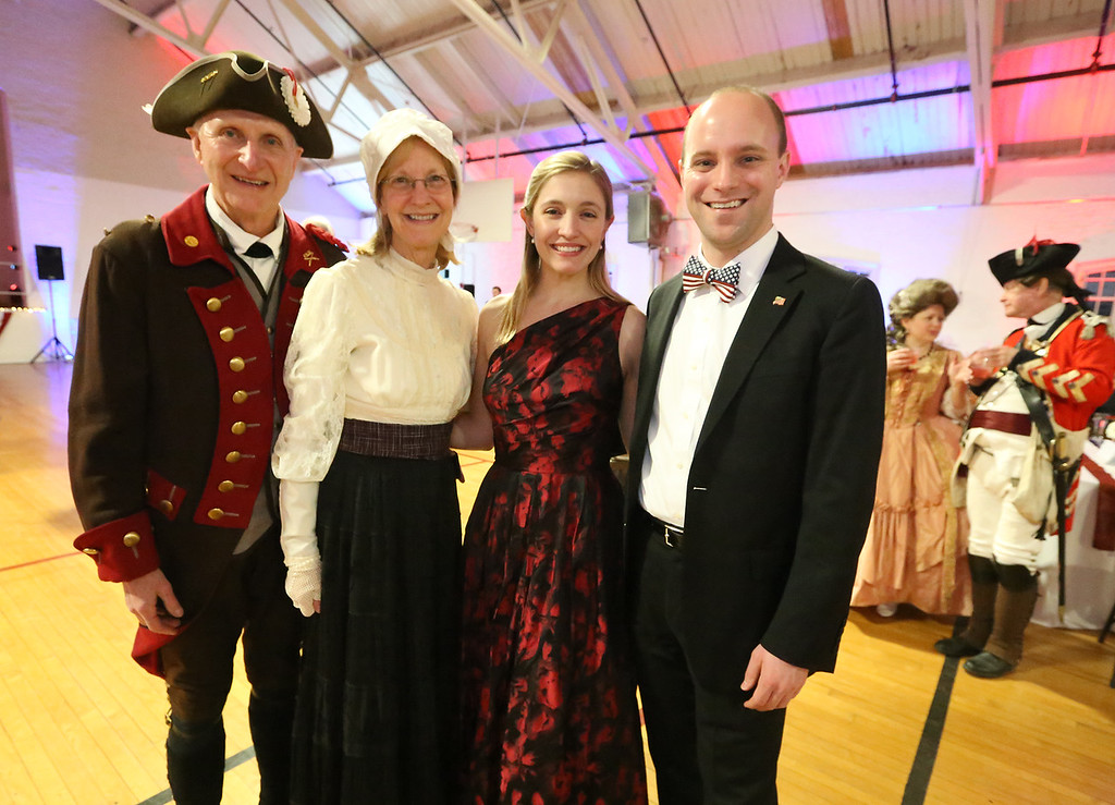 . Patriots\' Ball at Concord Armory. Roy Kring of Bedford, a member of the Bedford Minuteman Company, and his wife Shirley Kring of Bedford, with their son Ryan Kring, right, and his fiancee Rebecca Dillaway, both of Brookline. (SUN/Julia Malakie)