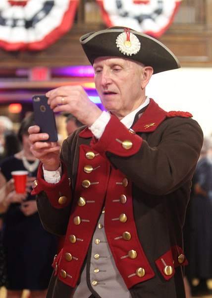 Patriots' Ball at Concord Armory. Roy Kring of Bedford, a member of the Bedford Minuteman Company, takes a photo. (SUN/Julia Malakie)