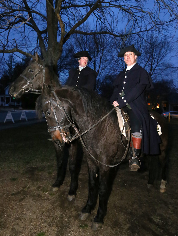 . Patriots\' Ball at Concord Armory. John Nichols of Williamsburg, VA, on Cincinnati, and Bob Allegretto of North Andover, who was playing Samuel Prescott, on Rondy, outside the Armory greeting arrivals. (SUN/Julia Malakie)