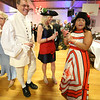 Patriots' Ball at Concord Armory. From left, Neil Rasmussen of Concord, and Kelly Benkert of Acton and Aura Bruce of Concord, co-presidents of the Guild of Volunteers for the Concord Museum. (SUN/Julia Malakie)