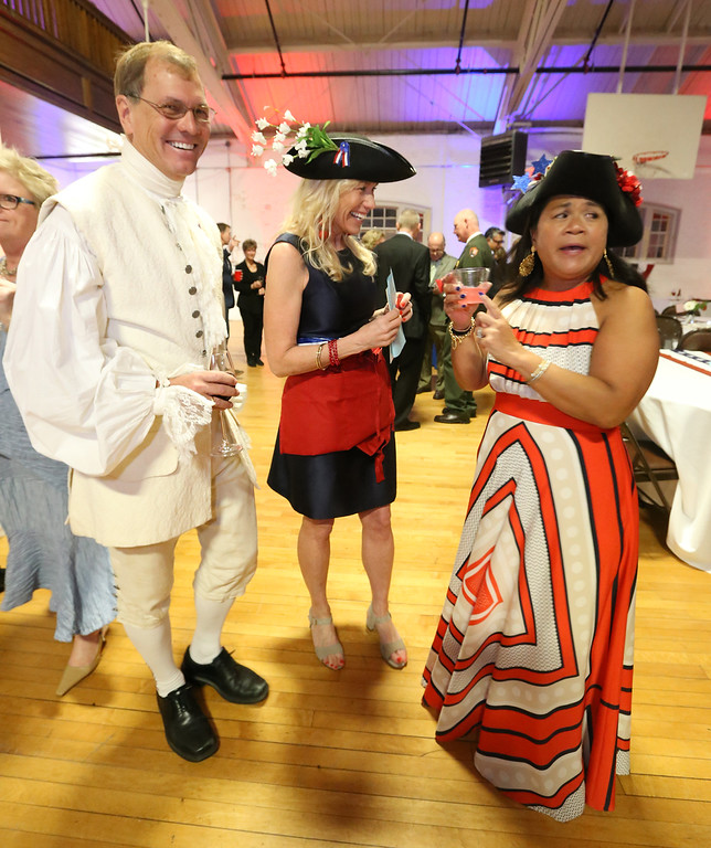 . Patriots\' Ball at Concord Armory. From left, Neil Rasmussen of Concord, and Kelly Benkert of Acton and Aura Bruce of Concord, co-presidents of the Guild of Volunteers for the Concord Museum. (SUN/Julia Malakie)