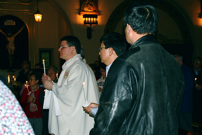 The procession continued after the candles were lit. Fr. Paul also ministers to Chinese Catholics at St. Clare's parish, and many of his parishioners were there.