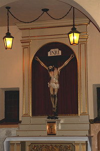 """Venerable Fr. Magin Catala's grave slab is to the left of this altar below the window. Fr. Catala is called """"The Holy Man of Santa Clara."""" The crucifix is the one that a witness saw come to life and lean down to embrace Fr. Catala, while the holy man was praying there."""