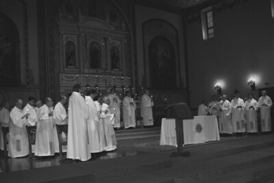 Jesuits with candles in Black and White. Santa Clara Mission Church.