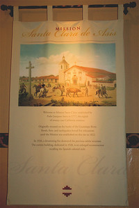 A banner from the back of the church that describes some of the history of Mission Santa Clara de Asis.