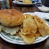 Fried chicken sandwich with home made potato chips.