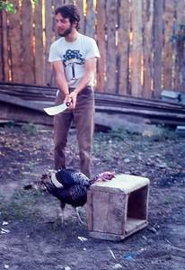 Perry Savino ready to decapitate turkey on Thanksgiving Day in Comayagua, Honduras 1979