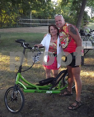 Sue and Brian Westfall with their eliptical bike.