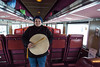 Skylene Metatawabin with hand drum on board coach 852 on the Polar Bear Express in Moosonee, Ontario.