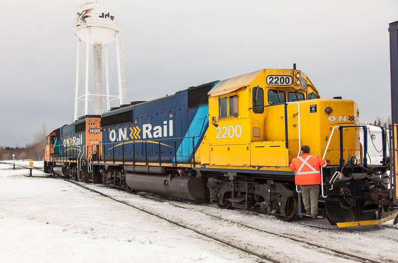 Locomotives 1808 and 2200 pull ahead of the Polar Bear Express before reversing and hooking on with flatcars for vehicles.