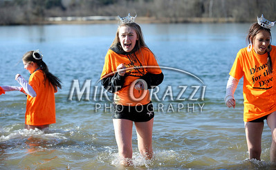 1/29/2012 Mike Orazzi | Staff Members of the Divas for the Dive Penguin Plunge team Kellie Lacko and Cheyenne O'Donnell during the Special Olympics Connecticut annual plunge at Winding Trails in Farmington on Sunday.