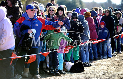 1/29/2012 Mike Orazzi | Staff New York Giants fan Brandon Ward of Bristol with part of the crowd on hand for the Special Olympics Connecticut annual plunge at Winding Trails in Farmington on Sunday.