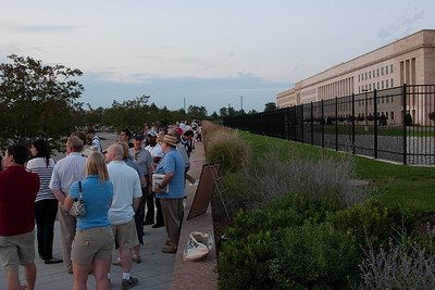 A docent (and former (?) Pentagon employee present that day), in straw hat, speaks to visitors. -- Tenth Anniversary of September 11, 2001 (9-11-11) at the Pentagon Memorial