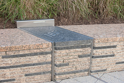 The benches are arranged by year of birth of the victim, with each year represented by a row. The years have markers like this at the end of each row. -- Tenth Anniversary of September 11, 2001 (9-11-11) at the Pentagon Memorial