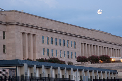 A full moon rises over the Pentagon (looking at east  face; memorial is off to the left). -- Tenth Anniversary of September 11, 2001 (9-11-11) at the Pentagon Memorial