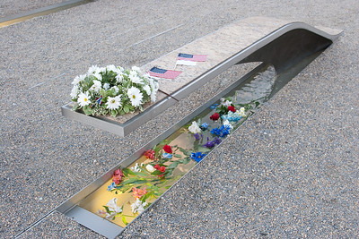 The pool under each bench is lit, just starting to be visible in this early evening (7:05pm) shot. -- Tenth Anniversary of September 11, 2001 (9-11-11) at the Pentagon Memorial