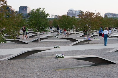The memorial benches are arranged such that the Pentagon victims' benches point away from the Pentagon (open to the right in this photo), while the Flight 77 victims' benches point towards the Pentagon (open to the left in this photo). -- Tenth Anniversary of September 11, 2001 (9-11-11) at the Pentagon Memorial