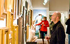 December 4th 2010 - Western North Carolina Plein Air Painters - Exhibit Opening - A customer admires a painting.