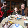 4th annual Cupcake Festival, to benefit Friends of the Lawrence Library in Pepperell. Eric Griffith, 9, of Pepperell, who made the cupcakes at right, his father Ben Griffith, and his grandfather Jack Atkinson of Westford, right. (SUN/Julia Malakie)