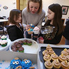 4th annual Cupcake Festival, to benefit Friends of the Lawrence Library in Pepperell. Debbie LaBrecque of Pepperell and daughters Audrey, 5, left, and Adrianna, 7, pick out cupcakes. (SUN/Julia Malakie)