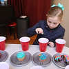 4th annual Cupcake Festival, to benefit Friends of the Lawrence Library in Pepperell. Ariya Craft, 6, of Pepperell, puts in a quarter to vote for a cupcake. People could vote for as many as they wanted.(SUN/Julia Malakie)