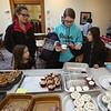 4th annual Cupcake Festival, to benefit Friends of the Lawrence Library in Pepperell. Sarah Taylor of Pepperell, second from right, and daughters Natalie, 4, Vanessa, 15, and Savanna, 7, pick out cupcakes. (SUN/Julia Malakie)