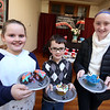 4th annual Cupcake Festival, to benefit Friends of the Lawrence Library in Pepperell. 1st place winner Lila Jean Dooney, 8, of Pepperell, her brother Jack Dooney, 7, who tied for 2nd place with Lauren Caruso (not present for announcement), and 3rd place winner Audrey Wiercinski, 11, of Groton. Winners were determined by votes at a quarter per vote. (SUN/Julia Malakie)
