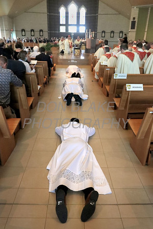 The 15 men 3 in each aisle prostrate them selves during their Ordination as Bishop Koenig and all the attendance pray at St. Joseph Church in Middletown, Saturday, August 7, 2021. Photo/Don Blake