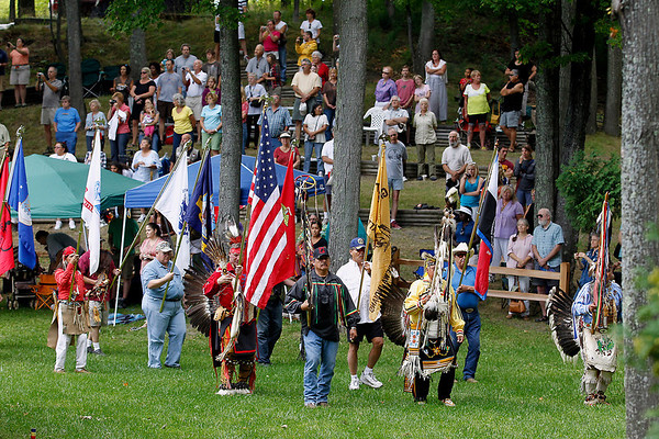 Record-Eagle/Jan-Michael Stump<br /> Flag-bearers lead the grand entry into Saturday's Peshawbestown Traditional Pow Wow.