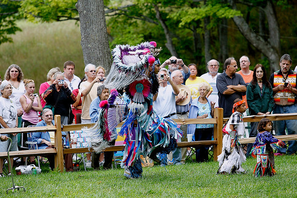 Record-Eagle/Jan-Michael Stump<br /> Donovan Waupoose (cq) dances in the grand entry of Saturday's Peshawbestown Traditional Pow Wow.
