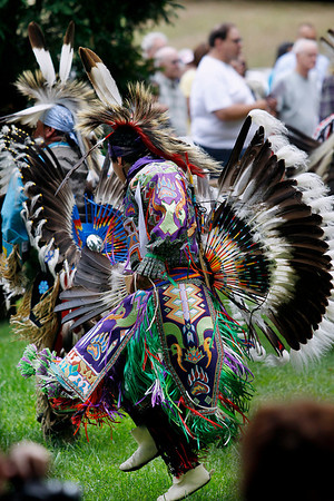 Record-Eagle/Jan-Michael Stump<br /> A male dancer enters the arena for the grand entry in Saturday's Peshawbestown Traditional Pow Wow.
