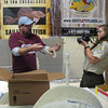 <b>Pet Amnesty Day, January 14, 2012</b> Eric Gehring of Marshall Foundation holds snake for USFWS Photographer-for-the-day Elizabeth Lesley