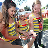 The girls of Amy's Dance Company (Cici Aden, center), hold the Madagascar Hissing Cockroach from The Bug Zooat at The Great Petaluma Chili Cookoff, Salsa and Beer Tasting held at Herzog Hall in the Sonoma-Marin Fairgrounds on Saturday May 12, 2012. Photo by Victora Webb