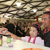 Cailey Tovar and dad Carlos Tovar take some Tree Hugging Hippy Chiliat The Great Petaluma Chili Cookoff, Salsa and Beer Tasting held at Herzog Hall in the Sonoma-Marin Fairgrounds on Saturday May 12, 2012. Photo by Victora Webb