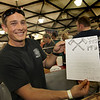 Shay Burke, fire fighter/paramedic for Petaluma Fire Departmet, shares the secret recepie of their success  at The Great Petaluma Chili Cookoff, Salsa and Beer Tasting held at Herzog Hall in the Sonoma-Marin Fairgrounds on Saturday May 12, 2012. Photo by Victora Webb