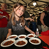 Maxx Zweers serves chili to the judges at The Great Petaluma Chili Cookoff, Salsa and Beer Tasting held at Herzog Hall in the Sonoma-Marin Fairgrounds on Saturday May 12, 2012. Photo by Victora Webb