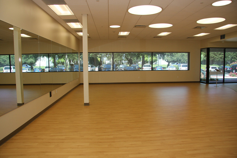 The health center offers a big beautiful room for dance and exercise.