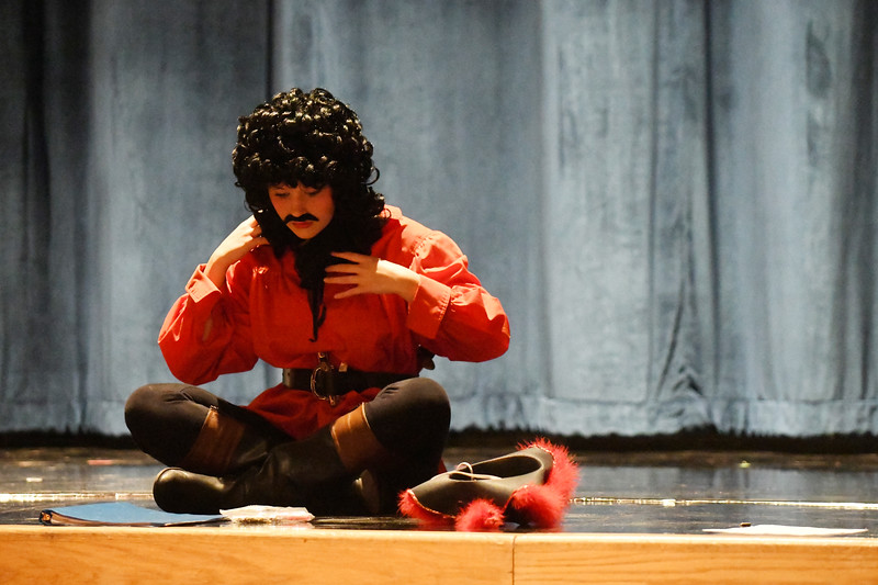 "Matthew Gaston | The Sheridan Press<br>Logen Livingston dawns a wig and mustache for her role as Black Stache in Sheridan High Schools dress rehearsal of ""Peter and the Starcatcher"" Tuesday, Nov. 27, 2018."