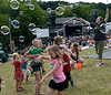 Children chase and pop bubbles at the 53rd Annual Philadelphia Folk Festival on Friday August 15,2014. Photo by Mark C Psoras/The Reporter