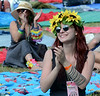 Ariane Kolet and aundience members applaud as Katie Frank & the Pheromones perform during an afternoon concert at the 53rd Annual Philadelphia Folk Festival on Friday August 15,2014. Photo by Mark C Psoras/The Reporter