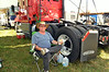 Using the truck as his camper,  long haul trucker Shelton Domian relaxesat the Philadelphia Folk Festival.   Thursday, August 14, 2014.   Photo by Geoff Patton