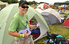 Kim Surkan strums his ukulele at his campsite at the Philadelphia Folk Festival in Upper Salford.    Thursday,   August 14, 2014.  Photo by Geoff Patton