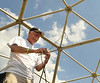 Ed Marliin assembles a stucture in the camping area at the Philadelphia Folk Festival in Upper Salford Township.   Thursday,  August 14, 2014.   Photo by Geoff Patton