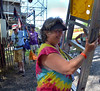 Judi Space moves a ladder as volunteers hang a banner.   (The Reporter/ Mark C. Psoras)