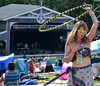 Corrine Dedrick dances and twirls a hula-hoop near the main stage.   (The Reporter/ Mark C. Psoras)