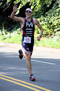 Winner Andy  Potts cruises towards the tape to set a course record of 1:46:03.